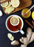 Antiviral ginger tea with lemon and honey on dark background. Top view. Useful Healthy drink Stock Photography