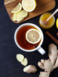 Antiviral healthy ginger tea with lemon and honey on dark background. Top view. Useful drink Royalty Free Stock Photos