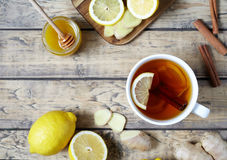 Antiviral useful drink ginger tea. Healthy . With lemon, honey and slices of  on wooden table. Royalty Free Stock Images
