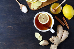 Antiviral useful drink ginger tea. With lemon, honey and slices on wooden table. Rustic Style. View from above. Royalty Free Stock Photos