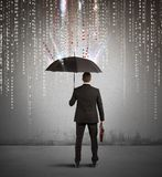 Antivirus and firewall concept. With businessman protected with umbrella Stock Image