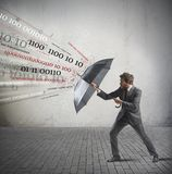 Antivirus and firewall concept. With businessman and umbrella Stock Images