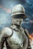 Antivirus.Medieval armor over clouds background. Concept of fire Royalty Free Stock Image