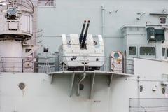 Antivliegtuigenkanonnen bij het slagschip van HMS Belfast in Londen, het UK Stock Afbeelding