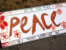 Antiwar peace sign. Placed on the roadside by a protester royalty free stock photography