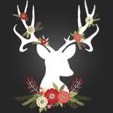 Antlers оленей рождества доски при установленные цветки Стоковые Фотографии RF