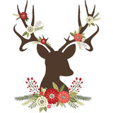 Antlers оленей рождества с цветками Стоковые Изображения