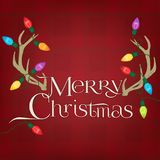 Antlers on a red plaid background with Christmas lights. Retro Christmas Lights hanging on Antlers with a red Plaid Background and words that say Merry Christmas Royalty Free Stock Images