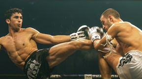 Antoine Pinto of France and Luca Novello of Italy in Thai Fight 2013. Stock Photo