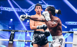 Antoine Pinto of France and Tu Warren of USA in Thai Fight Extreme 2013. Royalty Free Stock Images