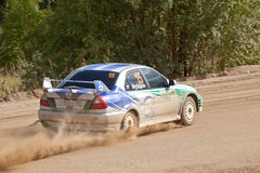 Anton Demeshco drives a Mitsubishi lancer car Stock Images