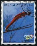 Anton Innauer from Austria at Winter Olympics at Lake Placid. RUSSIA KALININGRAD, 19 APRIL 2017: stamp printed by Paraguay, shows Anton Innauer from Austria at Royalty Free Stock Photo