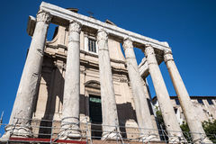 The  Antonino and Faustus Temple in  the Ancient Forum in Rome Italy. Rome Italy, the Eternal city, which has been a destination for tourists since the times of Stock Photos