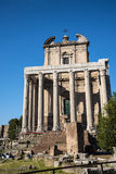 The  Antonino and Faustus Temple in  the Ancient Forum in Rome Italy. Rome Italy, the Eternal city, which has been a destination for tourists since the times of Royalty Free Stock Images