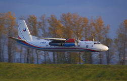 Antonov An-24. Flying low during airshow in Prague royalty free stock photo