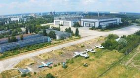 Antonov aircraft factory in Kiev. Shooting from the sky. Museum exhibits of Antonov aircraft near the hangar. 4k stock video footage
