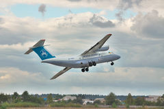 Antonov An-74 cargo plane. Gostomel, Ukraine - October 3, 2010: Antonov Airlines An-74 cargo plane is taking off into the cloudy sky Royalty Free Stock Photos