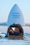 Antonov An-124. Gostomel, Ukraine - February 10, 2012. Antonov An-124 is loaded in the winter the airport to perform the flight in the interest of the UN mission Royalty Free Stock Photography