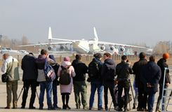 Antonov An-225 Mriya aircraft at Gostomel Airport, Kiev, Ukraine. KYIV, UKRAINE - APRIL 3,2018: Reporters looks on the Antonov An-225 `Mriya` aircraft during it` Stock Photos