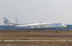 Antonov An-225 Mriya aircraft at Gostomel Airport, Kiev, Ukraine. KYIV, UKRAINE - APRIL 3, 2018: Ukrainian Antonov An-225 `Mriya` aircraft takes off from the Royalty Free Stock Image
