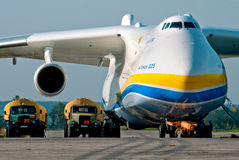 Antonov 225 Mrya fueling. Gostomel, Ukraine - September 28, 2012. Antonov 225 Mrya fueling by two heavy-vehicle fuel tankers Royalty Free Stock Photo