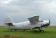 Antonov plane. Old renovated Antonov plane standing on grass field stock image