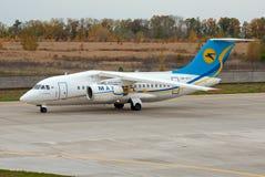 Antonov An-148 plane. Borispol, Ukraine - October 19, 2012. A Antonov An-148 plane from the airline Ukraine International Airlines taxing in Borispol stock image