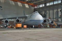 Antonov An-124 Ruslan maintenance. Kiev, Ukraine - August 3, 2011: Antonov An-124 Ruslan cargo plane being checked and maintenanced in hangar royalty free stock photography