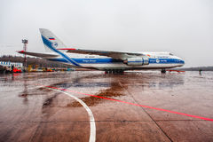Antonov An-124-100 Ruslan Volga-Dnepr Airlines parking at Moscow airport Domodedovo. In rainy weather stock photos