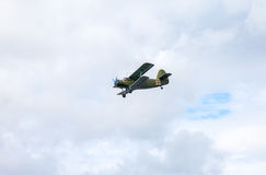 The Antonov An-2 is a Soviet  biplane in flying against cloudy s Royalty Free Stock Photos