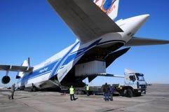 Antonov AN-124 Unloading. Russian Volga-Dnepr Antonov AN-124 long-range heavy transport plane is being unloaded in Yubileiny airport in Baikonur, Kazakhstan, on stock photos
