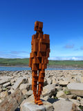 Antony Gormley sculpture Kimmeridge Bay, Dorset. Cast-iron, life size sculpture of a man staring out to sea Stock Images
