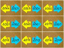 Antonym concepts of new year versus old year written on opposite arrows. Photo collage of antonym concepts of new year versus old year written on yellow and blue Royalty Free Stock Photos