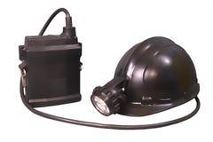 Antorcha y casco del almacenaje para el minero y los salvavidas Foto de archivo libre de regalías