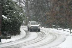 Antreiben in Schnee Stockbild