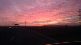 Antreiben am Sonnenuntergang Lizenzfreies Stockbild