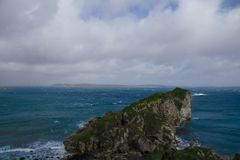Antrim Coast with blue cloudy sky at Kinbane Castle,. Ireland, north-ireland stock photography