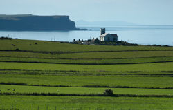 Antrim Coast, Ireland. Local church set against the backdrop of the Atlantic Ocean stock photography