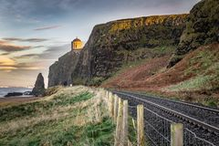 Antrim Coast Railway. This is a picture of the railtracks that run along the Antrim Coast. In the distance you can see Mussenden Temple on the edge of the cliff royalty free stock photography