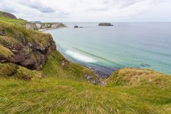 The Antrim Coast. Antrim/N. Ireland - May 30, 2015: The scenic northern coastline of Antrim in N. Ireland. Hillside and rocks lead down to the North Sea stock photos