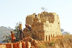 Africans working hard in brickyard - Madagascar. ANTSIRABE, MADAGASCAR, SEPTEMBER 2014, Unknown Africans working hard in brickyard - Madagascar royalty free stock images