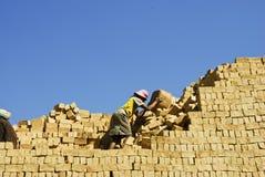 Unknown Africans working hard. ANTSIRABE, MADAGASCAR, SEPTEMBER 13, 2014: Unknown Africans working hard in brickyard - Madagascar stock image