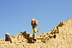 Unknown Africans working hard. ANTSIRABE, MADAGASCAR, SEPTEMBER 13, 2014: Unknown Africans working hard in brickyard - Madagascar royalty free stock photos