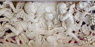 Antwerp - Baroque relief in marble. Obeisance of angels for eucharist in St. Jacobs church (Jacobskerk). On September 5, 2013 in Antwerp, Belgium stock photo