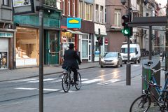 A rabbi riding a bicycle in Antwerpen, belgium royalty free stock photo