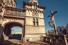 Medieval fortress Het Steen with brick archway and Jesus on stone cross. ANTWERP, BELGIUM - MAR 30: Medieval fortress Het Steen with brick archway and Jesus on Stock Photo