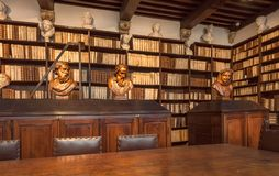 Rare library books and antique statues in printing museum of Plantin-Moretus, UNESCO World Heritage Site Royalty Free Stock Photo
