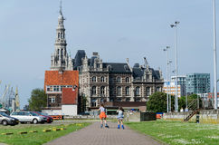 Antwerp, Belgium - May 11, 2015: Children roller skating against pilotage building Stock Image