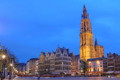 Antwerp, Belgium. Night scene in downtown Antwerp, Belgium along the famous Meir Street and the lonely tower of the  Cathedral of our Lady Royalty Free Stock Photography