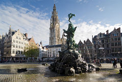 Antwerp. BELGIUM - OCTOBER 26: The Grand Place with the Statue of Brabo, throwing the giant's hand into the Scheldt River and the Cathedral of our Lady Stock Photo